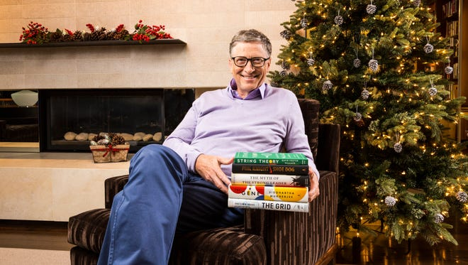 In the holiday spirit: Bill Gates with his favorite books this year.