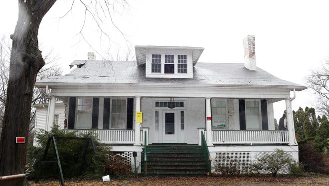 Demolition is underway at 2833 Tremont Drive in the Upper Highlands. Landmarks officials and neighbors had sought to declare the home a landmark, but the landmarks' decision was overturned and the owners have since been allowed to demolish it.