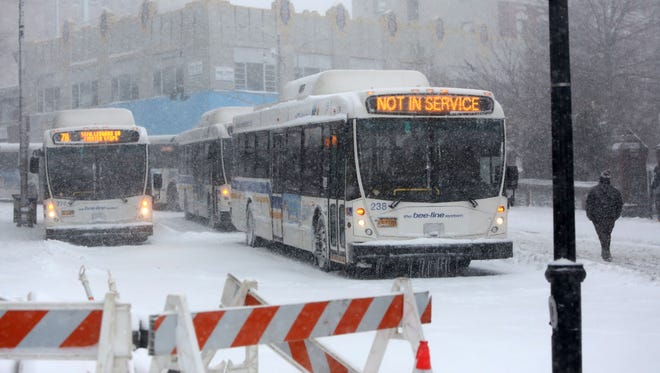 Buses parked in downtown Yonkers wait to resume service during a steady snowfall Feb. 9, 2017.