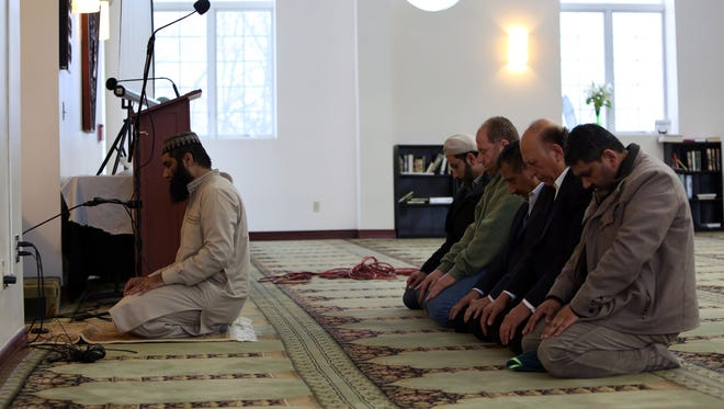 Imam Saleem Qadri leads a prayer at the Islamic Center of Rockland during an open house for the community Feb. 12, 2017 in Valley Cottage. The center held an open house so the community can become familiar with the mosque and Islam in response to supportive emails after President Donald Trump's Muslim ban.