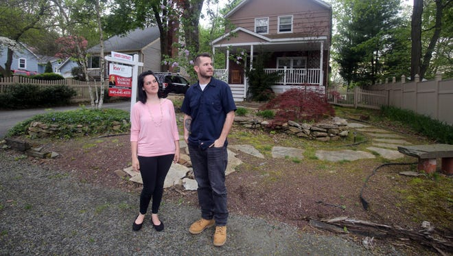 Katie and Joe Nash in front of the home they are purchasing in the Lake Lucille community in New City May 1, 2017. Inventory of single family homes in the Lower Hudson region causing a tight real estate market.