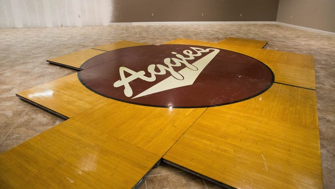 The center circle for the former Pan American Center parquet basketball court is on display at Ashley Furniture HomeStore. This piece and other sections of Lou Henson Court will be auctioned off Saturday, May 6, 2017, at the store.