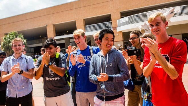 Students cheer for their classmates during an academic signing day celebration at Gulf Coast High School on Thursday, May 4, 2017.