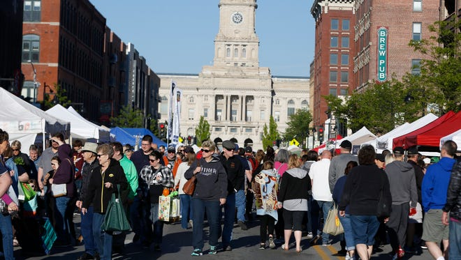 Market goers fill court avenue Saturday, May 6, 2017 on opening day of the Downtown Farmers' Market in Des Moines.