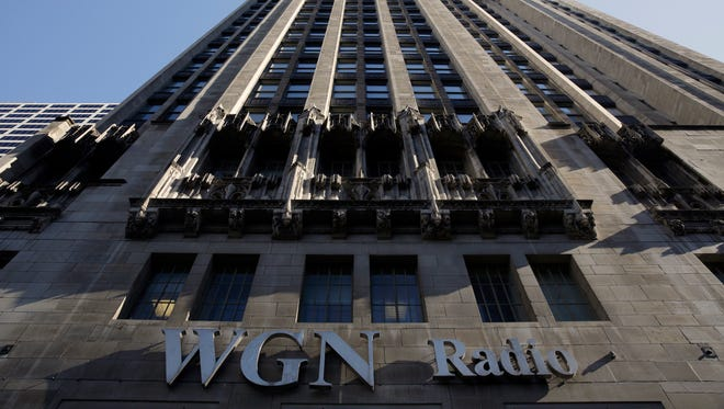 The WGN Radio sign appears on the side of Tribune Tower on May 1, 2017, in downtown Chicago. The nation's largest broadcast group, Sinclair is reportedly close to acquiring Tribune Media.