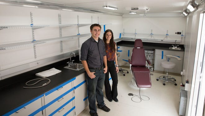 ASU grad students Nick Kemme and Sara Mantlik pose inside their completed mobile dental clinic. Kemme and Mantlik will graduate on May 10, 2017, with degrees in mechanical engineering. The clinic will be used to help people in Arizona, California and Nicaragua.