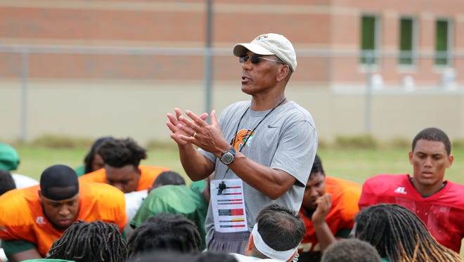 FAMU head coach Alex Wood addresses his team after its final scrimmage of fall camp on Saturday.