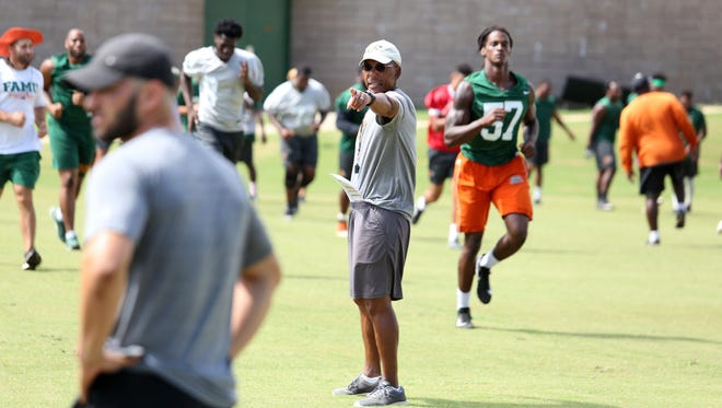 FAMU head coach Alex Wood directs his players during the final scrimmage of fall camp.
