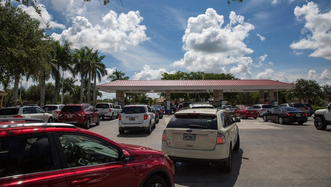 Cars line up to purchase gasoline in preparation for Hurricane Irma at the North Naples Costco gas station Tuesday, Sept. 5, 2017. On Monday, Florida Gov. Rick Scott issued a state of emergency for the state.