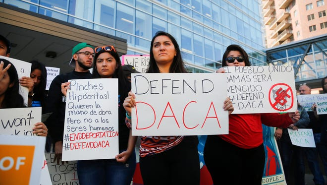 More than 100 gather for a rally supporting immigrants outside the federal building  in Des Moines following the suspension of the DACA program on Sept. 5.
