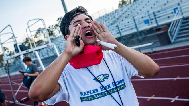 Naples High School drum major Luis Nicacio practices with the marching band on Wednesday, Oct. 11, 2017. Nicacio has been invited to perform in the Macy's All-American Marching Band.