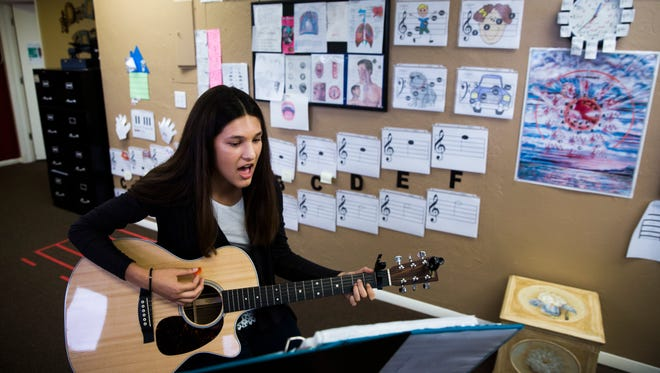 Alexis Anand, 13, practices during a voice lesson Friday, Oct. 20, 2017, in Fort Myers. She will perform with Camp Broadway at the 91st annual Macy's Thanksgiving Day Parade in New York City.