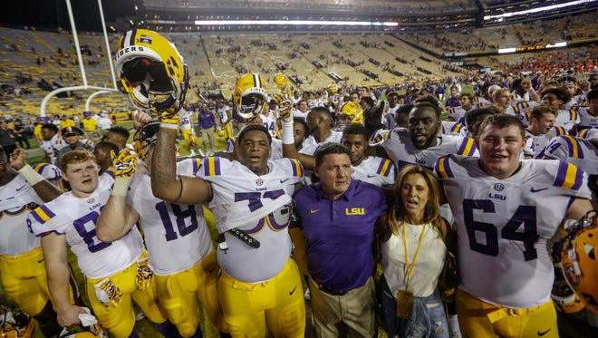 LSU coach Ed Orgeron celebrates with his team following a win against Syracuse on Sept. 23, 2017