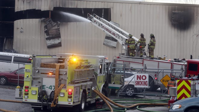 Firefighters battle a fire after an explosion at the Verla International plant, a manufacturer of cosmetics in New Windsor, New York. Nov. 20, 2017.