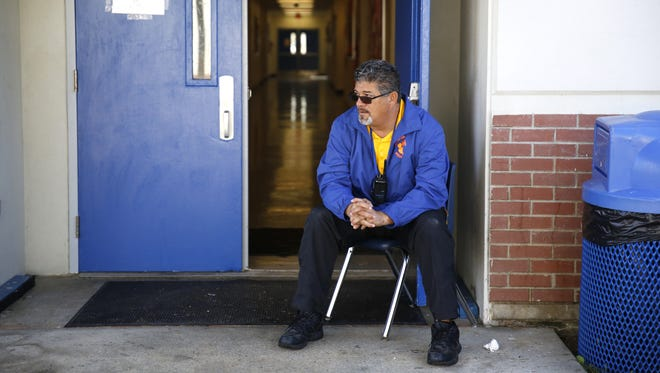 Security Guard Eddie Arza at Somerset Jefferson charter school Nov 29. Principal Cory Oliver says having security guards in every pavilion has cut down on disruptions caused by students being out of class.