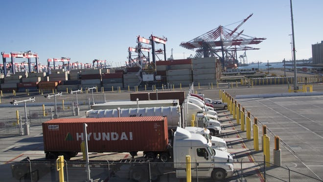 Trucks wait to unload and pick up containers at the Port of Long Beach.