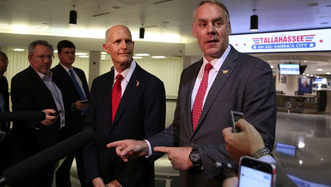 Florida Gov. Rick Scott (left) and U.S. Interior Secretary Ryan Zinke, announce there will be no new offshore drilling in the State of Florida. Both met at the Tallahassee International Airport, Tuesday, Jan. 9, 2018.