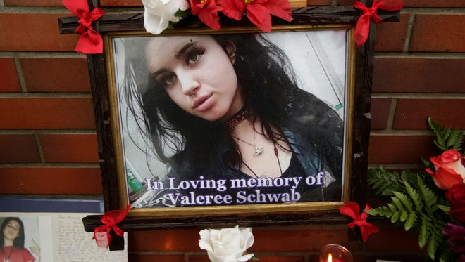 A memorial has been set up for Valaree Schwab, 16, a New Rochelle student at the Dunkin' Donuts in New Rochelle on Jan. 12, 2018, where she was fatally stabbed to death two days earlier. Another student was charged. Ricky Flores/lohud