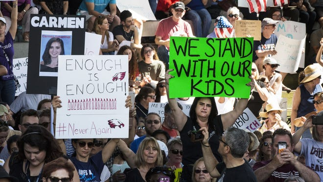 Donna Biederman, bottom right, gets emotional while listening to speeches during a gun control rally in front of the federal courthouse in Fort Lauderdale, Fla. on Feb. 17, 2018. Students, community members, elected officials and gun control advocates gathered together to call for common sense gun laws and firearm safety legislation in the wake of the school shooting that left 17 people dead and 15 others injured this past Wednesday in Parkland, Fla.