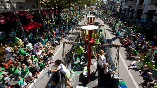 Thousands gather, adorned in green garb, for the annual St. Patrick's Day Parade along Fifth Avenue South on Saturday, March 17, 2018, in Naples.
