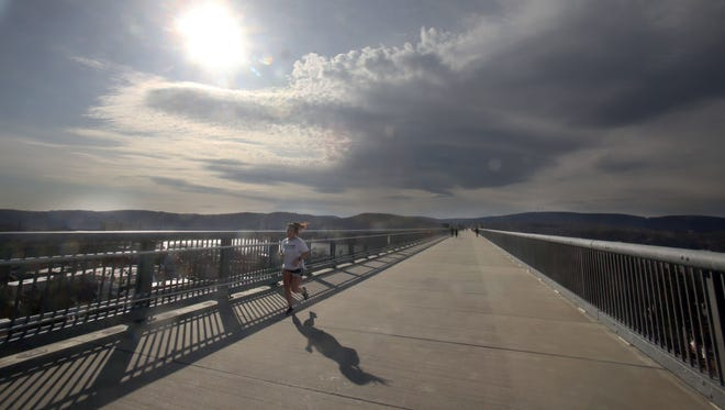 A runner makes her way over the Walkway Over the Hudson. A runner makes her way over the Walkway Over the Hudson in Poughkeepsie Feb. 28, 2018.