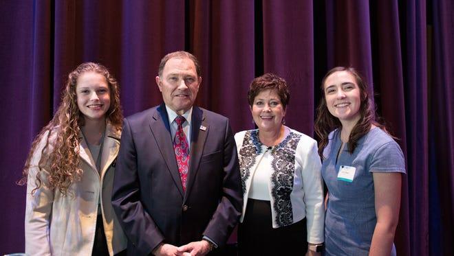 "Olivia Allen of Fort Herriman Jr. High, (from left) Utah Gov. Gary Herbert; first lady Jeanette Herbert and Claire Allen of Cedar City High at ""Hamilton."""