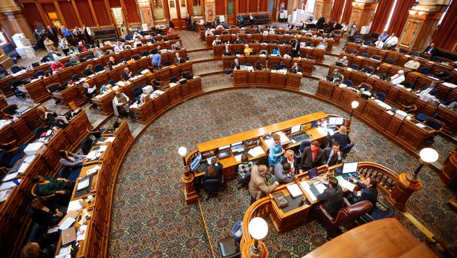 Representatives discuss a procedural issue during the debate on the fetal heartbeat abortion bill on the floor of the Iowa House Tuesday, May 1, 2018.