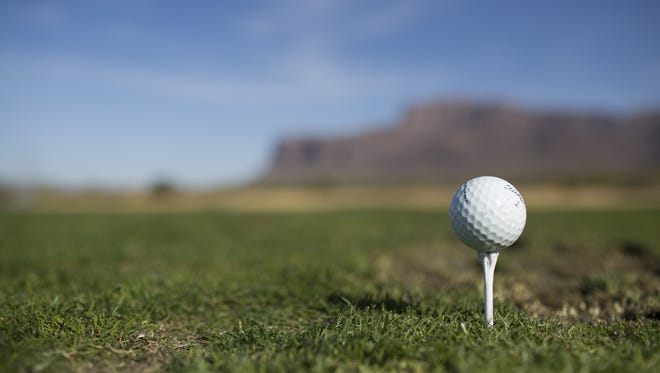 A golf ball sits on a tee at the Superstition Mountain Golf & Country Club in Gold Canyon, Arizona,  on Feb. 1, 2018.