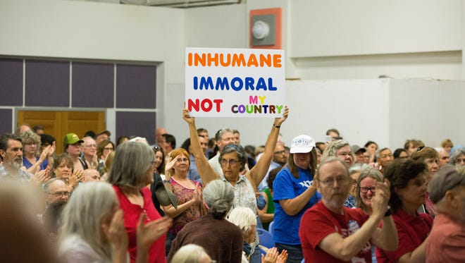 Residents protest the Trump Administration's immigration policies at the Keep Families Together Unity Event, Friday June 22, 2018 at Alma d'arte Charter High School.