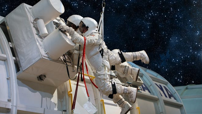 Mission specialists perform a critical Extravehicular Activity, or spacewalk, to repair an ammonium tank on the International Space Station.