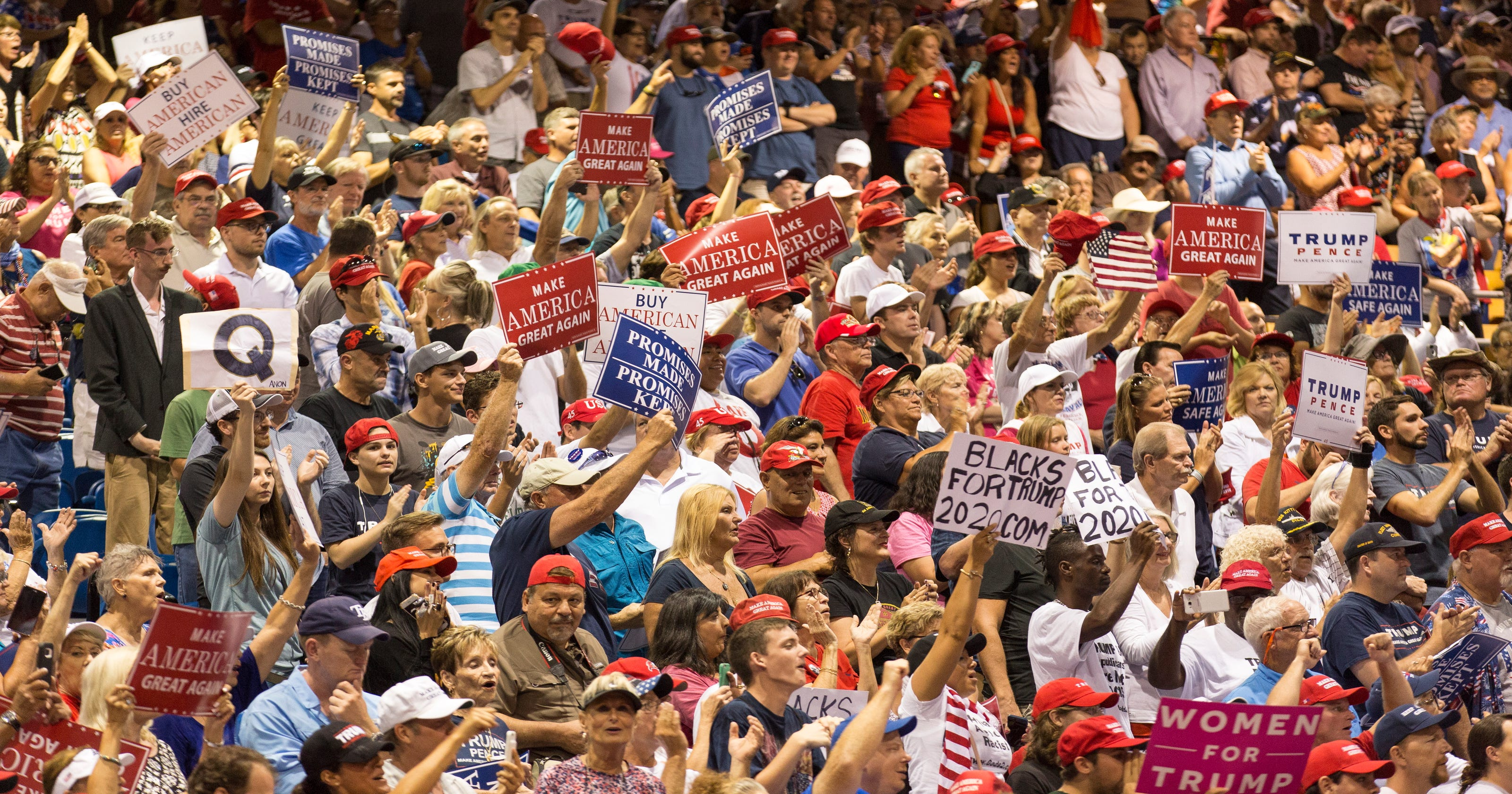 QAnon: The conspiracy theory explained, after Q posters spotted at Trump's Florida rally