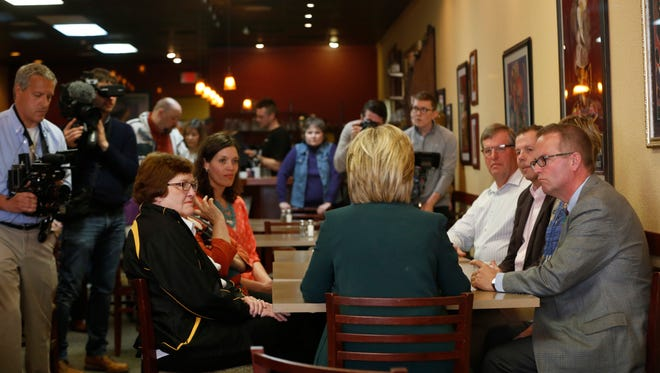Former Iowa lieutenant governor Patty Judge, seated, left, joined Hillary Clinton, center, at the Tremont Grille in Marshalltown on April 14, 2016.
