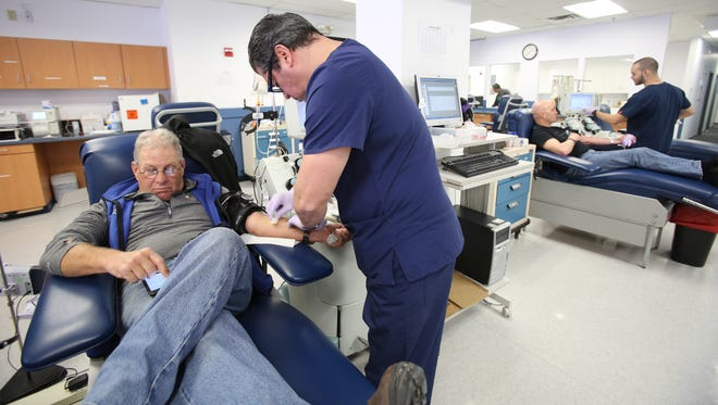 Ira Kotler of Scarsdale donates blood at New York Blood Center in Elmsford. The center opened its doors Wednesday in hopes of getting more donations of blood and platelets.