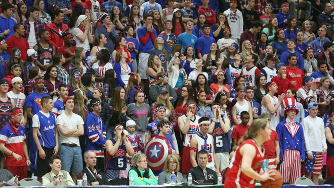 Albertus Magnus students watch the girls basketball team Friday during its state semifinal loss to Jamesville-DeWitt.