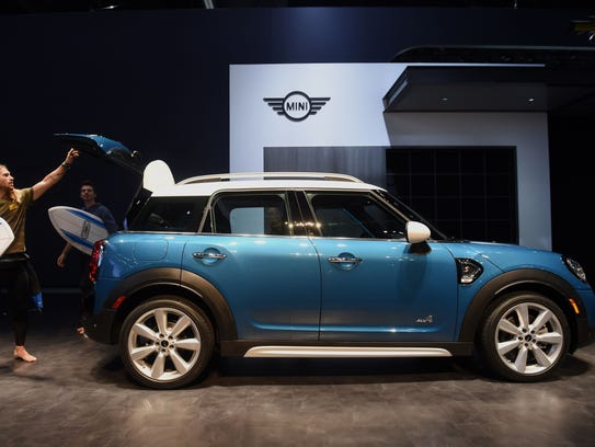 Actors unload surfboards from the all new 2017 Mini