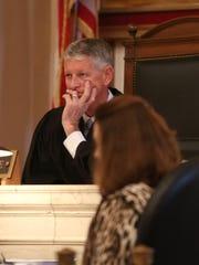 Judge Dinkelacker listens to Louis Sirkin, Tracie Hunter's attorney, during Monday's hearing.