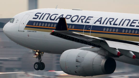 A Singapore Airlines Airbus A330 lands at Singapore