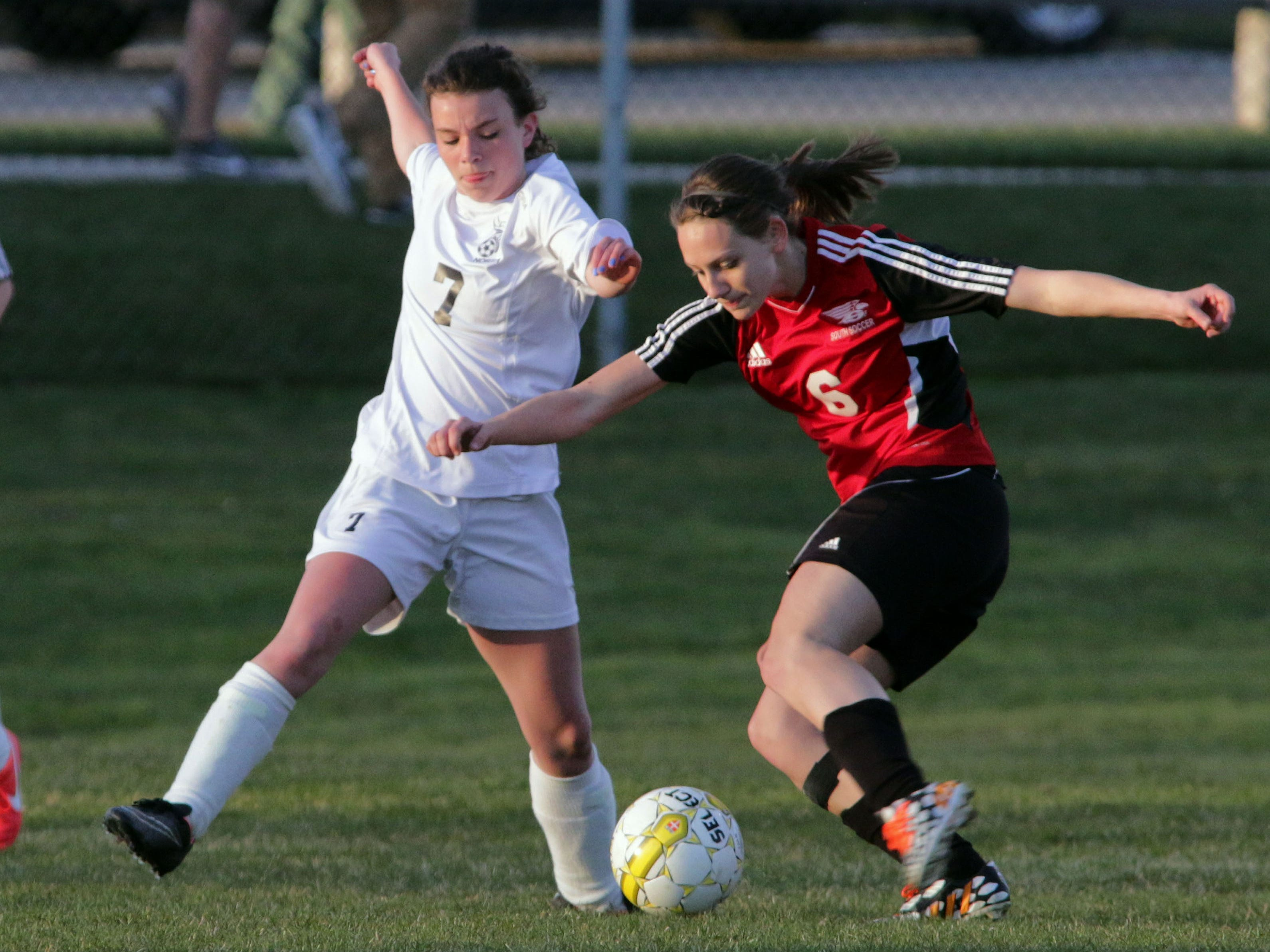 Sheboygan North's Mallory Veeser (7) and Sheboygan South's Baylee Rivas (6) battle for the ball Tuesday at the Horace Mann Soccer Complex.