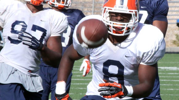 UTEP linebacker Johnny Jones, 8, chases a pass during