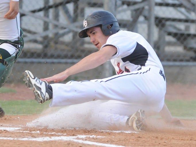 North Buncombe's JT Bateman slides home during the MAC tournament baseball finals at Reynolds Thursday. John Coutlakis 5-8-14