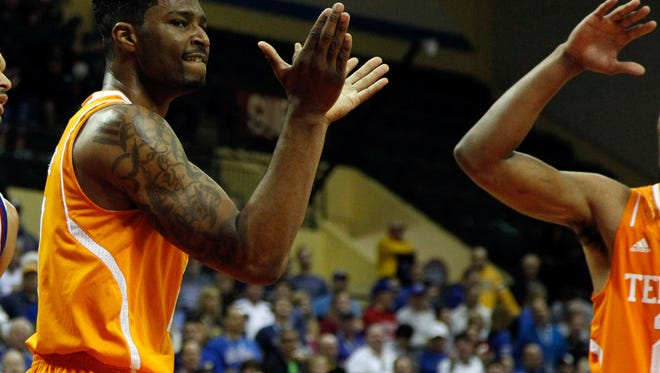 Nov 28, 2014; Kissimmee, FL, USA; Tennessee Volunteers forward Jabari McGhee (21) claps and reacts against the Kansas Jayhawks  during the first half at HP Field House. Mandatory Credit: Kim Klement-USA TODAY Sports