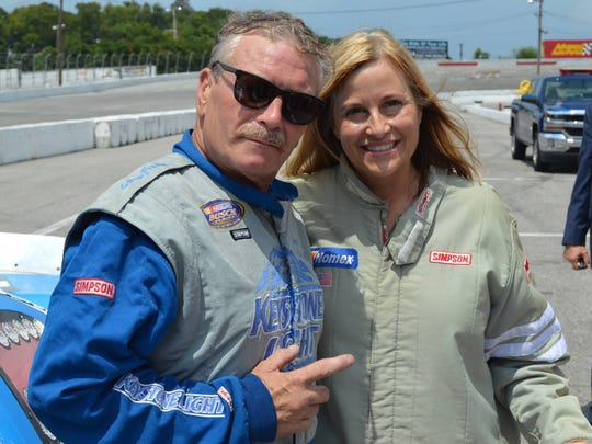 Tony Formosa poses with former Mayor Megan Barry at the fairgrounds racetrack in Nashville.