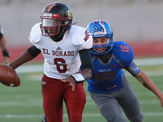 El Dorado quarterback Cedarious Barfield scrambles away from Americas defender Jason Vargas last year. Barfield was named First-Team All-State in Class 6A football on Friday by the Texas Sports Writers Association.
