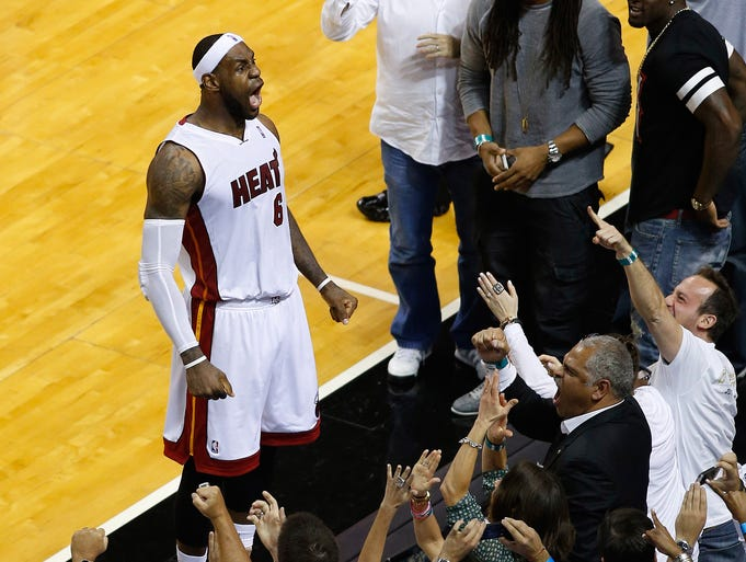 Game 5 in Miami -- Heat 96, Nets 94: LeBron James celebrates Miami's series-clinching victory.