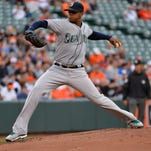 May 20, 2015; Baltimore, MD, USA; Seattle Mariners starting pitcher Roenis Elias (29) pitches during the first inning against the Baltimore Orioles at Oriole Park at Camden Yards. Mandatory Credit: Tommy Gilligan-USA TODAY Sports