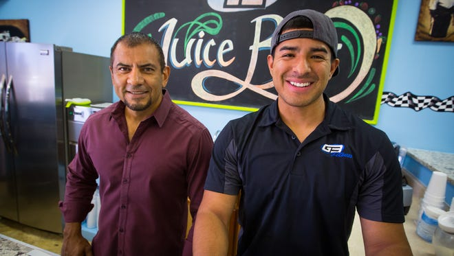 Owner of G3 Fitness, Fito Gallardo, left, and his son Jacob Gallardo stand behind the counter of the juice bar at the fitness center, June 1, 2016.