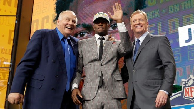 Former Green Bay Packers player Jerry Kramer and NFL commissioner Roger Goodell pose with Iowa's Josh Jackson after Jackson was selected by the Packers during the second round of the draft.