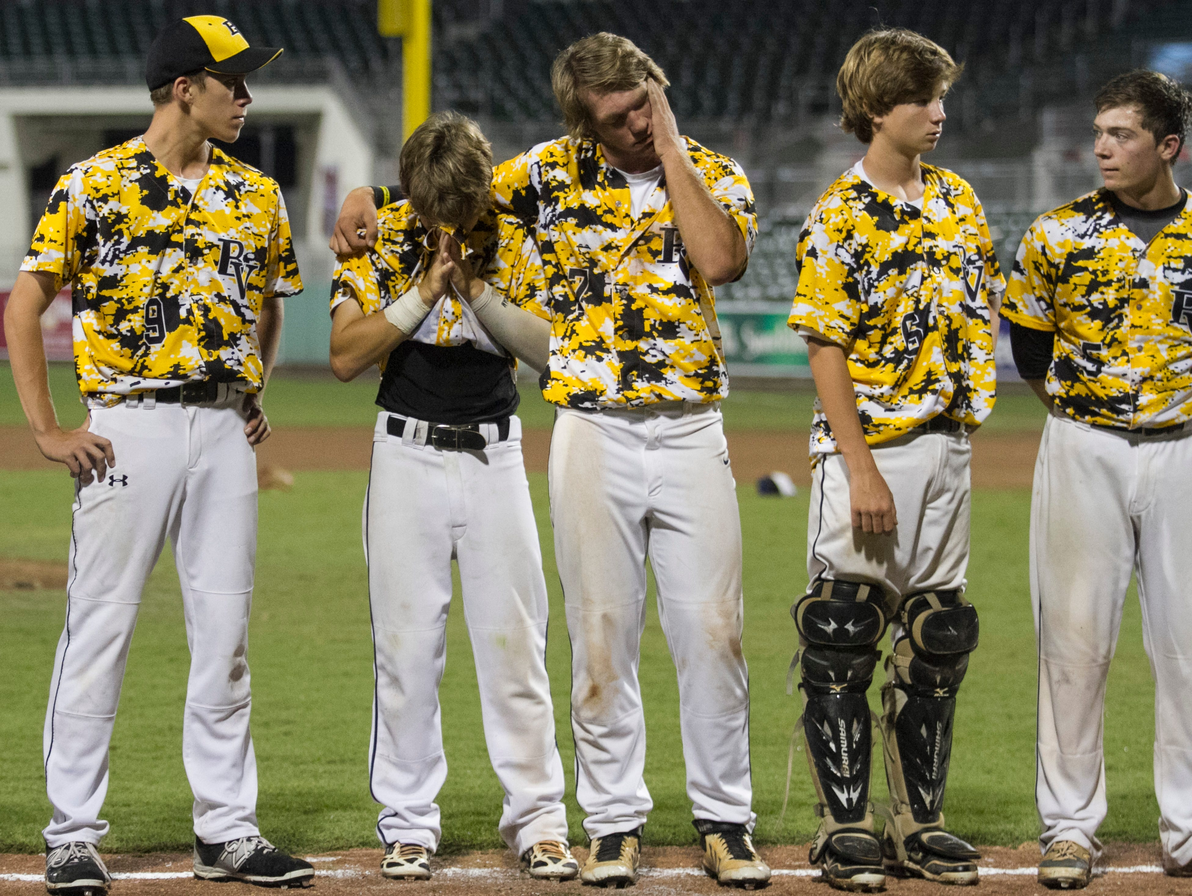 Bishop Verot players show their disappointment after losing to Jacksonville Trinity Christian in the Class 4A State Baseball final on Tuesday, May 19, 2015, at JetBlue Park in south Fort Myers.