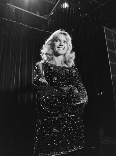 Olivia Newton-John tapes a TV show in Paris, on Nov. 25, 1978.