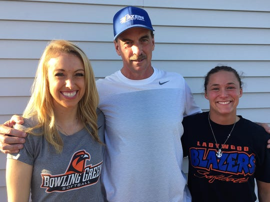 Former Ladywood head coach Scott Combs poses with Blazers alumnae Briana Combs (left) and Jenny Kelley.